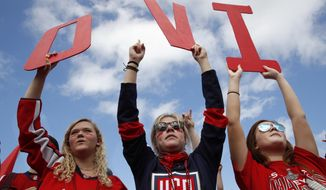 Olivia Spicer, 16, left, Emma Jacobs, 17, and Caroline Schwartz, 18, all of Gainesville, Va., hold up letters spelling the nickname of Washington Capitals' left wing Alex Ovechkin, from Russia, on the National Mall ahead of a victory parade and rally for the Washington Capitals as hockey fans celebrate their winning the Stanley Cup, Tuesday, June 12, 2018, in Washington. (AP Photo/Jacquelyn Martin) ** FILE **