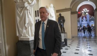 Rep. Mark Meadows, R-N.C., center, chairman of the conservative House Freedom Caucus, walks to the House chamber at the Capitol in Washington, Thursday, June 21, 2018. (AP Photo/J. Scott Applewhite) ** FILE **