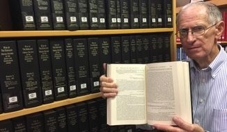 "In this June 2018 photo, Cass County historian Charles Steger shows the 47 volumes of ""The War of the Rebellion: A Compilation of the Official Records of the Union and Confederate Armies"" at the Atlanta Public Library in Atlanta, Texas. Even longtime historian Steger is impressed by one holding at the library. (Christy Busby/The Texarkana Gazette via AP)"