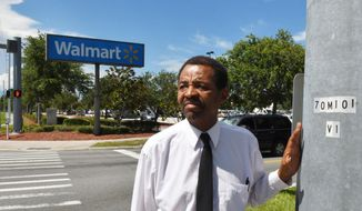 Standing near the Cocoa Walmart. Pastor Tommy Studstill, whose ministry is called Greater Love For the Homeless, feels that the Walmart stores that he has dealt with are very understanding of the homeless. (Tim Shortt/Florida Today via AP)