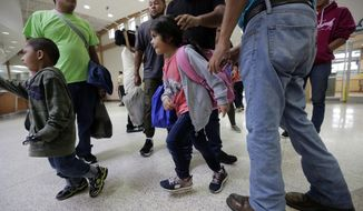 A group of immigrants from Honduras and Guatemala seeking asylum arrive at the bus station after they were processed and released by U.S. Customs and Border Protection, Thursday, June 21, 2018, in McAllen, Texas. President Donald Trump signed an executive order to end family separations at the border. (AP Photo/Eric Gay)