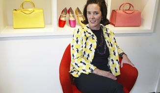 FILE - In this May 13, 2004, file photo, designer Kate Spade sits during an interview in New York. Spade is being buried in Kansas City, where she was born, and services are planned for 3 p.m. Thursday, June 21, 2018, at Our Lady of Perpetual Help Redemptorist Church. Spade was found dead by suicide on June 5 in her New York City home. She was 55 and had a 13-year-old daughter. (AP Photo/Bebeto Matthews, File)