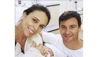 In this photo released by New Zealand Prime Minister Jacinda Ardern on Instagram, Thursday, June 21, 2018, Ardern and her partner Clarke Gayford pose with their newborn daughter at the Auckland City Hospital, Thursday, June 21, 2018, in Auckland, New Zealand. (Jacinda Ardern via AP)