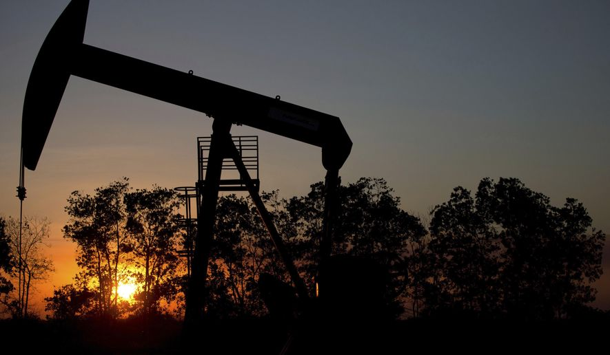In this Feb. 19, 2015, file photo, the sun sets behind an oil well in a field near El Tigre, Venezuela. Ministers from the Organization of the Petroleum Exporting Countries and non-OPEC nations led by Russia meet in Vienna on Friday, June 22, 2018, and Saturday, June 23. (AP Photo/Fernando Llano, File)