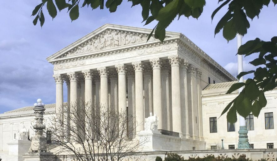 This April 23, 2018, file photo shows the Supreme Court in Washington. The Supreme Court says states can force online shoppers to pay sales tax. The 5-4 ruling Thursday is a win for states, who said they were losing out on billions of dollars annually under two decades-old Supreme Court decisions that impacted online sales tax collection. The high court ruled Thursday to overturn those decisions. (AP Photo/Jessica Gresko, File)