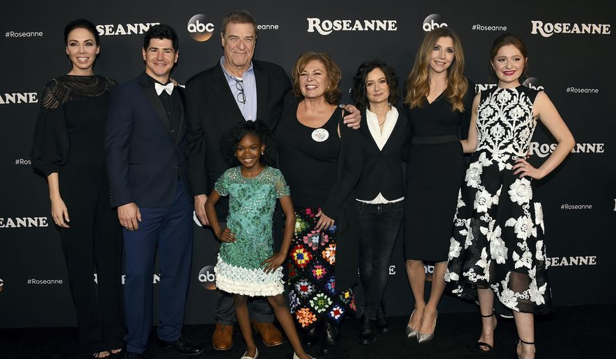"""In this March 23, 2018, file photo, from left, Whitney Cummings, Michael Fishman, John Goodman, Jayden Rey, Roseanne Barr, Sara Gilbert, Sarah Chalke and Emma Kenney arrive at the Los Angeles premiere of """"Roseanne"""" in Burbank, Calif. (Photo by Jordan Strauss/Invision/AP, File)"""