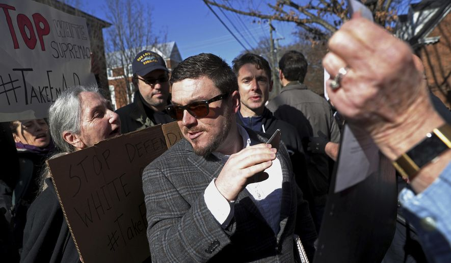 """FILE - In this Feb. 27, 2018 file photo, Jason Kessler walks through a crowd of protesters in front of the Charlottesville Circuit Courthouse ahead of a decision regarding the covered Confederate statues, during a rally in Charlottesville, Va.  The National Park Service says it has approved an application for a """"Unite the Right"""" anniversary rally to be held in front of the White House.   Organizer Jason Kessler's application describes it as a """"white civil rights"""" rally. He says he wants elected officials in Washington to know that the violence that killed a woman and injured others in Charlottesville was provoked by what he's calling """"civil rights abuse.""""   (Zack Wajsgras/The Daily Progress via AP, File)"""