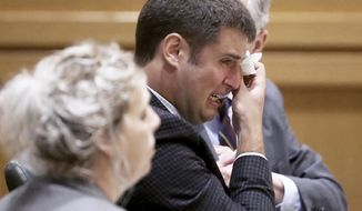 Former UW-Madison student Alec Cook reacts to comments made by Dane County Circuit Judge Stephen Ehlke during his sentencing hearing at the Dane County Courthouse in Madison, Wis., Thursday, June 21, 2018. Cook was sentenced to three years in prison for committing a series of sexual assaults on or near the campus in 2015 and 2016. (John Hart/Wisconsin State Journal via AP)