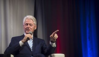 Former United States President Bill Clinton speaks at the Beanfield Centre in Toronto on Friday June 22, 2018. (Tijana Martin/The Canadian Press via AP)