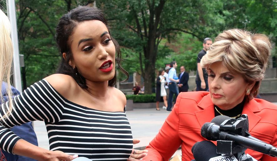 Former Houston Texans cheerleader Angelina Rosa demonstrates during a news conference outside NFL headquarters in New York, Friday, June 22, 2018,  how she says she was forced to use duct tape to make her look skinnier during a game last year. Her attorney Gloria Allred, right, looks on. Rosa joins five other Texans cheerleaders in a lawsuit alleging the team failed to fully compensate them as required by law and subjected them to hostile work environment in which they were harassed, intimidated and forced to live in fear. (AP Photo/Ted Shaffrey) **FILE**