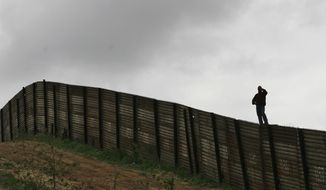 The U.S.-Mexico border fence near Smuggler's Gulch west of the San Ysidro Port of Entry in San Diego on April 27, 2006. (Associated Press) **FILE**