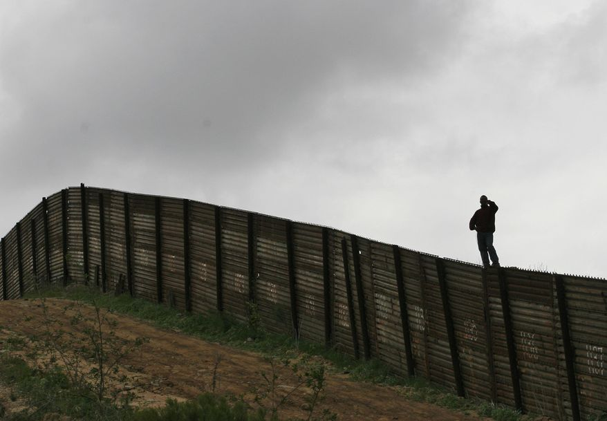 The U.S.-Mexico border fence near Smuggler's Gulch west of the San Ysidro Port of Entry in San Diego on April 27, 2006 (Associated Press) **FILE**