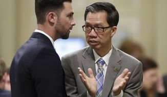 FILE -- In this June 16, 2016 file photo Democratic Assemblyman Ed Chau, of Arcadia, right talks with Assemblyman Ian Calderon, D-Whittier at the Capitol in Sacramento, Calif. Lawmakers are expected to vote next week on an internet privacy bill Chau is carrying, that could keep a related initiative off the November ballot. (AP Photo/Rich Pedroncelli)