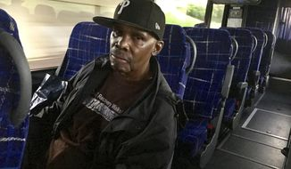 "In this May 2018 photo, Lorenzo Belton, of Germantown, rides on the Philadelphia Prison Society bus to Smithfield and Huntingdon, in central Pennsylvania. Belton said he is on a fixed income, so these bus trips are a financial hardship. But, he said, ""I think it's worth it. I'm going to see my son, to share some love."" (Samantha Melamed/The Philadelphia Inquirer via AP)"