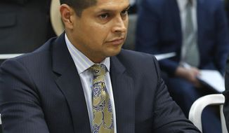 FILE -- In this June 14, 2016 file photo Assemblyman Miguel Santiago, D-Los Angeles, appears before the Senate Public Safety Committee, in Sacramento, Calif. Santiago says, Friday, June 22, 2018, that his family is being harassed online because he altered a bill aimed at restoring net neutrality. (AP Photo/Rich Pedroncelli, file)
