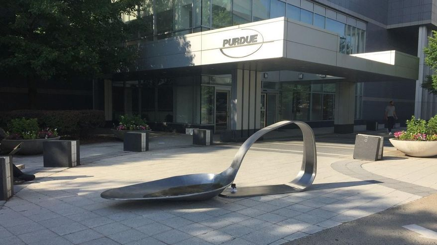 "An 800-pound sculpture, titled ""Purdue,"" created by artist Domenic Esposito is displayed outside the Connecticut headquarters of drugmaker Purdue Pharma, Friday, June 22, 2018, in Stamford, Conn. The sculpture was inspired to create by Esposito's brother's battle with addiction. Several state and local governments are suing Purdue Pharma for allegedly using deceptive marketing to boost sales of its opioid painkiller OxyContin, blamed for opioid overdose deaths. (Susan Dunne/Hartford Courant via AP)"