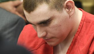 In this June 8, 2018, file photo, school shooting suspect Nikolas Cruz sits in the Broward County courthouse in Fort Lauderdale, Fla. (Taimy Alvarez/South Florida Sun-Sentinel via AP, Pool, File)