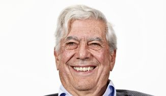 FILE - In this April 24, 2013 file photo, Peruvian writer and Nobel Prize winner in literature Mario Vargas Llosa smiles during a press conference at the presentation of a new theater play in Madrid, Spain. Vargas Llosa is under observation, Thursday, June 21, 2018,  at a Madrid hospital after sustaining light injuries in a fall at home. (AP Photo/Daniel Ochoa de Olza, File)