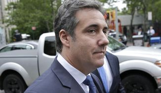 File - In this May 30, 2018 file photo, attorney Michael Cohen arrives to court in New York. President Donald Trump's former attorney retweeted a photo posing with comedian Tom Arnold, who is working on a show to hunt down recordings of the president. The photo fueled speculation Friday, June 22, 2018, that Cohen has secret tapes of Trump and is willing to share them. (AP Photo/Seth Wenig, File)
