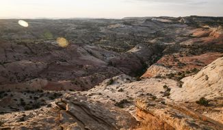 This July 9, 2017 photo, shows a view of Grand Staircase-Escalante National Monument in Utah.  A Canadian company is telling investors it plans to mine on Utah lands that were cut out of the Grand Staircase-Escalante National Monument by President Trump in a move that is angering environmental groups who are suing to reverse the downsizing. (Spenser Heaps/The Deseret News via AP)