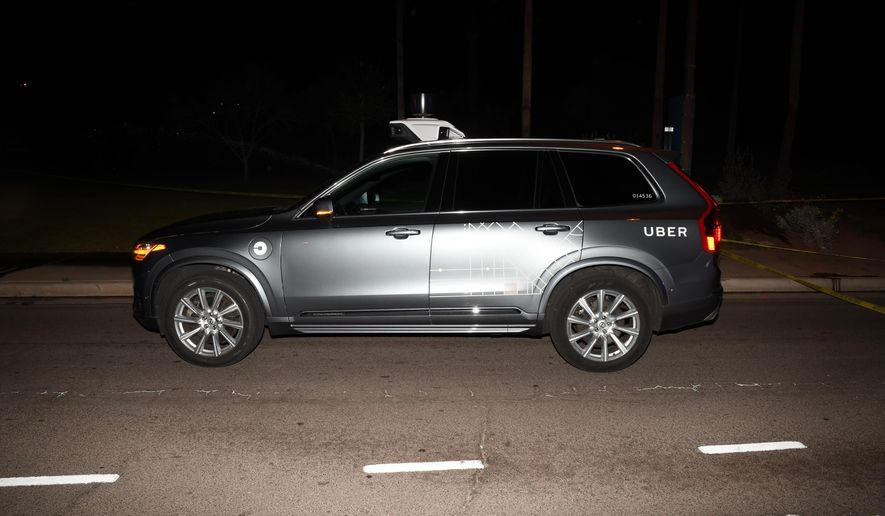 """This image provided by the Tempe Police Department shows an Uber SUV after hitting a woman on March 18, 2018 in Tempe, Ariz.  The human backup driver in an autonomous Uber SUV was streaming the television show """"The Voice"""" just before the vehicle struck and killed an Arizona pedestrian in March, according to a published report. The Arizona Republic reported that the driver was streaming the musical talent show on Hulu in the moments before the crash on a darkened street in the Phoenix suburb of Tempe.  (Tempe Police Department via AP)"""