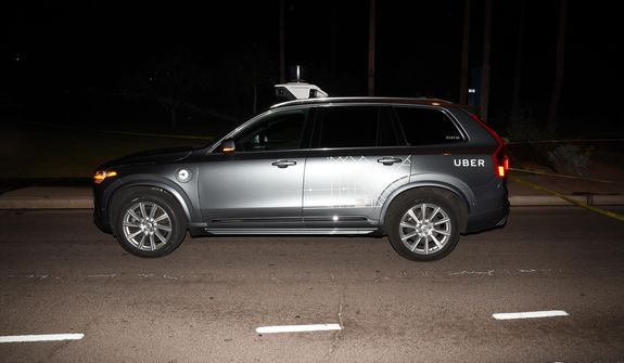 "This image provided by the Tempe Police Department shows an Uber SUV after hitting a woman on March 18, 2018 in Tempe, Ariz.  The human backup driver in an autonomous Uber SUV was streaming the television show ""The Voice"" just before the vehicle struck and killed an Arizona pedestrian in March, according to a published report. The Arizona Republic reported that the driver was streaming the musical talent show on Hulu in the moments before the crash on a darkened street in the Phoenix suburb of Tempe.  (Tempe Police Department via AP)"