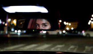 Hessah al-Ajaji drivers her car down the capital's busy Tahlia Street after midnight for the first time in Riyadh, Saudi Arabia, Sunday, June 24, 2018. Saudi women are in the driver's seat for the first time in their country and steering their way through busy city streets just minutes after the world's last remaining ban on women driving was lifted on Sunday. (AP Photo/Nariman El-Mofty)