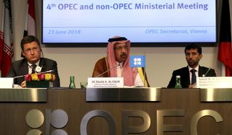 Russian Minister of Energy Alexander Novak, Khalid Al-Falih Minister of Energy, Industry and Mineral Resources of Saudi Arabia and Minister of Energy of the United Arab Emirates, UAE, Suhail Mohamed Al Mazrouei, from left, attend a news conference after a meeting of the Organization of the Petroleum Exporting Countries, OPEC, and non OPEC members at their headquarters in Vienna, Austria, Saturday, June 23, 2018. (AP Photo/Ronald Zak)