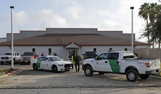 """A U.S. Border Patrol Agent walks between vehicles outside the Central Processing Center Saturday, June 23, 2018, in McAllen, Texas. Members of Congress toured the facility Saturday morning. Over 2,000 children were taken from their families in recent weeks under a Trump administration """"zero tolerance"""" policy in which people entering the U.S. illegally face being prosecuted. Parents and children were being detained separately. But after public outcry, President Donald Trump on Wednesday ordered that they be brought back together. (AP Photo/David J. Phillip)"""