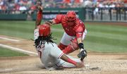 Philadelphia Phillies' Maikel Franco, left, comes home to score against Washington Nationals catcher Spencer Kieboom, right, during the second inning of a baseball game, Saturday, June 23, 2018, in Washington. (AP Photo/Nick Wass)
