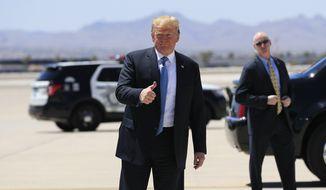 President Donald Trump gestures upon arrival at McCarran International Airport in Las Vegas, Saturday, June 23, 2018. (AP Photo/Manuel Balce Ceneta)