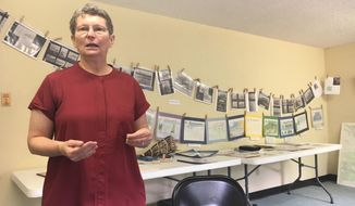 In this June 11, 2018 photo Amy Viltrakis talks about the Salcha Historical Society she helped found at their museum in Fairbanks, Alaska. The community of about 1,000 people in Salcha, in the middle of the Fairbanks North Star Borough, has a richer history than you might think, and retired teacher Viltrakis is on a mission to document it. The three-room historical museum has photographs and artifacts related to old homesteads, roadhouses, gold mining, the Salchaket band of Athabascans, the Salcha telegraph station, the old Valdez Trail and more. (Amanda Bohman/Fairbanks Daily News-Miner via AP)