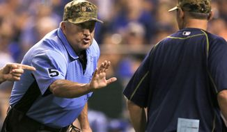 FILE - In this May 30, 2016, file photo, home plate umpire Dale Scott (5) talks with Tampa Bay Rays manager Kevin Cash, right, after a play review during the eighth inning of a baseball game against the Kansas City Royals at Kauffman Stadium in Kansas City, Mo. When the Los Angeles Dodgers asked Scott to throw a ceremonial first pitch, he was honored of course, but also a little apprehensive. His first question: Could he just hand the ball to the catcher instead? Scott is a Eugene, Ore., native who graduated from Sheldon High in 1977. (AP Photo/Orlin Wagner, File)