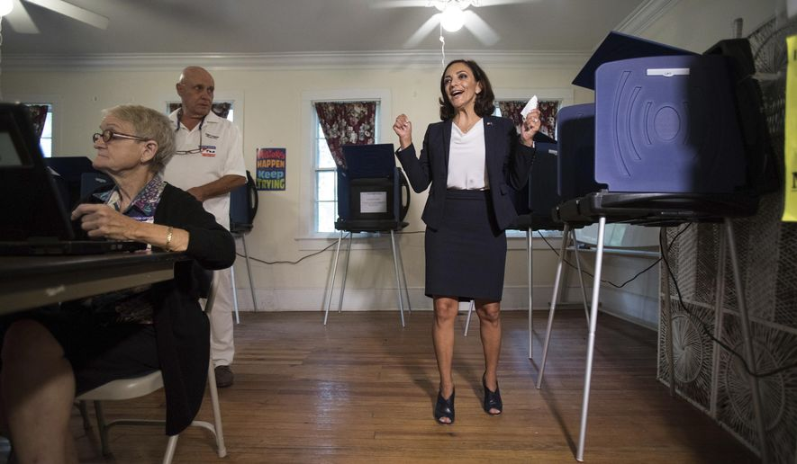 FILE - In this June 12, 2018 file photo, South Carolina Rep. Katie Arrington, who is running for the first district of South Carolina, celebrates after casting her vote at Bethany United Methodist Church in Summerville.  Arrington who defeated U.S. Rep. Mark Sanford in his re-election bid has been seriously injured in a deadly wreck.  Spokesman Michael Mule tells media outlets Arrington has undergone surgery for her injuries and was recovering Saturday, June 23, 2018,  in a Charleston-area hospital.  (Kathryn Ziesig/The Post And Courier via AP, File)
