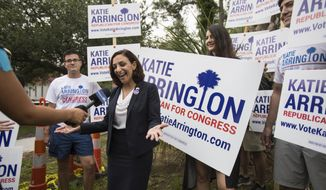 In this June 12, 2018 file photo, South Carolina Rep.Katie Arrington, who is running for the first district of South Carolina, campaigns after voting for herself in the primary election at Bethany United Methodist Church in Summerville.  Arrington who defeated U.S. Rep. Mark Sanford in his re-election bid has been seriously injured in a deadly wreck.  Spokesman Michael Mule tells media outlets Arrington has undergone surgery for her injuries and was recovering Saturday, June 23, 2018,  in a Charleston-area hospital. (Kathryn Ziesig/The Post And Courier via AP, File)