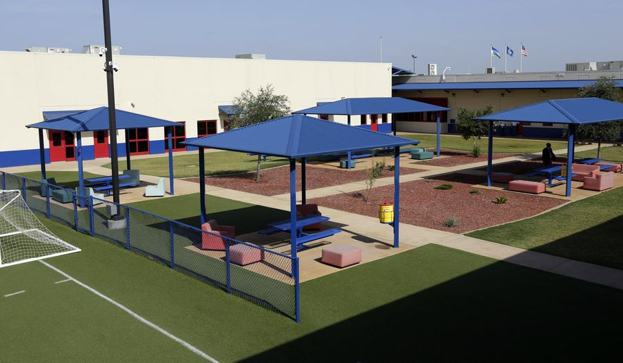 FILE - In this July 31, 2014, file photo, a courtyard is seen at the Karnes County Residential Center in Karnes City, Texas. The immigration detention facility has been retooled to house adults with children who have been apprehended at the border. The Trump administration is calling for the expanded use of family detention for immigrant parents and children who are stopped along U.S.-Mexico border, a move descried by advocates as a cruel and ineffective attempt to deter families from coming to the United States.   (AP Photo/Eric Gay, File)