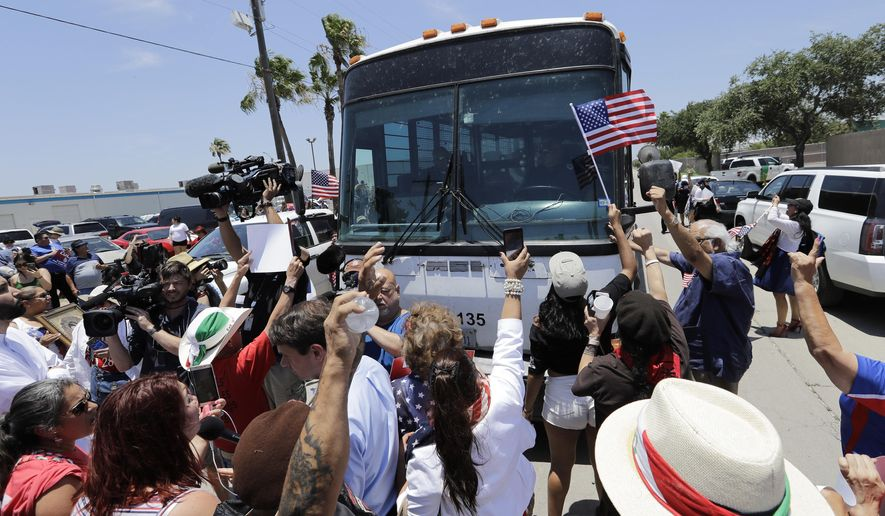 Demonstrators block a bus with immigrant children onboard during a protest outside the U.S. Border Patrol Central Processing Center Saturday, June 23, 2018, in McAllen, Texas. Extra law enforcement officials were called in to help control the scene and allow the bus to move out. (AP Photo/David J. Phillip)