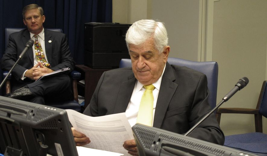 Senate President John Alario, R-Westwego, studies a budget spreadsheet in the Senate Finance Committee on Saturday, June 23, 2018, in Baton Rouge, La. The committee advanced a budget bill to spend $463 million in sales taxes that are expected to be raised for the upcoming budget year. (AP Photo/Melinda Deslatte)