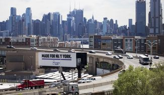 "Traffic spirals up and down a section of Route 495 to the Lincoln Tunnel, Thursday, June 21, 2018, in Weehauken, N.J. An estimated two-and-a-half-year rehabilitation project on a separate section of 495 will create ""severe congestion"" according to the state's Department of Transportation. The New York City skyline is in the background. (AP Photo/Mark Lennihan)"