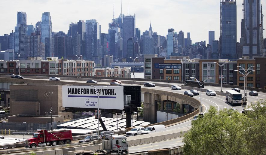 """Traffic spirals up and down a section of Route 495 to the Lincoln Tunnel, Thursday, June 21, 2018, in Weehauken, N.J. An estimated two-and-a-half-year rehabilitation project on a separate section of 495 will create """"severe congestion"""" according to the state's Department of Transportation. The New York City skyline is in the background. (AP Photo/Mark Lennihan)"""