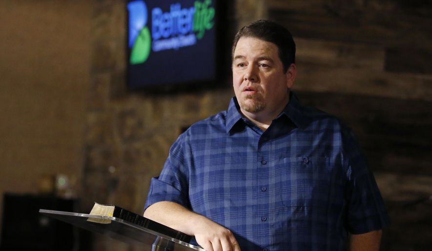Pastor Danny Daniels poses for a photo inside his Better Life Community Church in Lindsay, Okla., Friday, June 15, 2018. Daniels is among a growing group of traditionally conservative Republican voters who have shifted their position in favor of medical marijuana and who could ensure passage on Tuesday of the first medical marijuana state question on a ballot this year. (AP Photo/Sue Ogrocki)