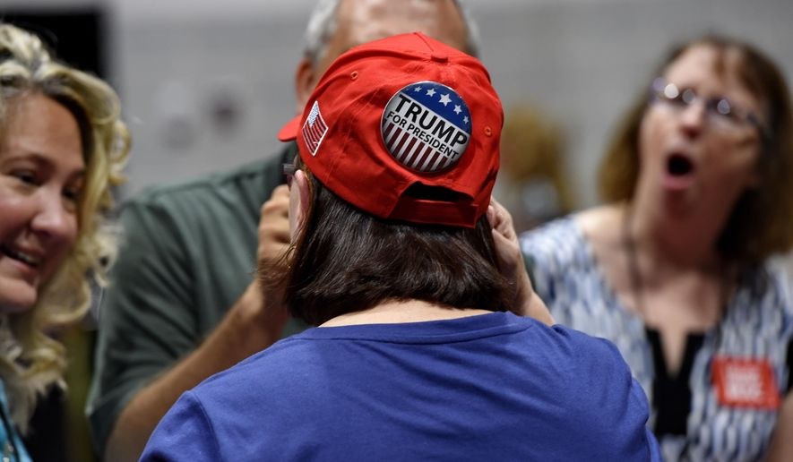 Trump supporters talk before a rally featuring Vice President Mike Pence who is in town to rally for Gov. Henry McMaster on the Coastal Carolina campus Saturday, June 23, 2018, in Conway, S.C. (AP Photo/Richard Shiro)