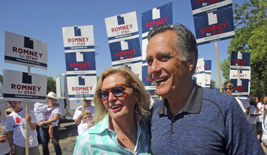 Mitt and Ann Romney walk in the Strawberry Day Parade Saturday, June 23, 2018, in Pleasant Grove, Utah. Romney is flashing his familiar smile at city parks and backyards in Utah's mountains and suburbs this week, making his final pitch after being forced into a Republican primary against a conservative state lawmaker. At stake is being the party's representative to vie for the Senate seat long held by retiring Republican Sen. Orrin Hatch. (AP Photo/Rick Bowmer)