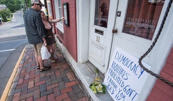 The Red Hen restaurant in Lexington, Virginia, asked White House press secretary Sarah Huckabee Sanders to leave Friday because of her association with President Trump. (Associated Press/File)