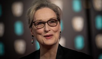 Meryl Streep poses for photographers upon arrival at the BAFTA Film Awards, in London, Sunday, Feb. 12, 2017. (Photo by Vianney Le Caer/Invision/AP)