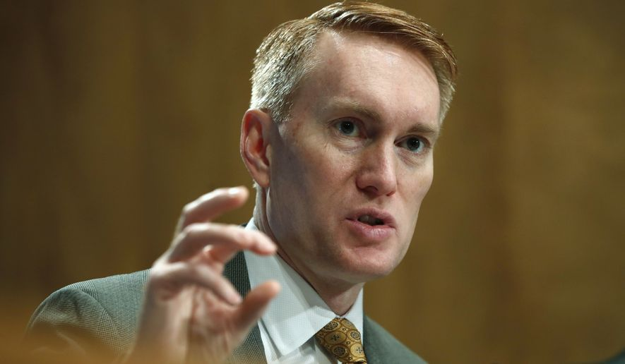 Sen. James Lankford, R-Okla., asks a question during a Senate Governmental Affairs subcommittee hearing on international mail and the opioid crisis, Thursday, Jan. 25, 2018, on Capitol Hill in Washington. China said Thursday it is ready to work with the United States in fighting illicit opioid shipments after congressional investigators found that Chinese opioid manufacturers exploit weak screening in the U.S. Postal Service to ship large quantities of illegal drugs to American dealers. (AP Photo/Jacquelyn Martin)