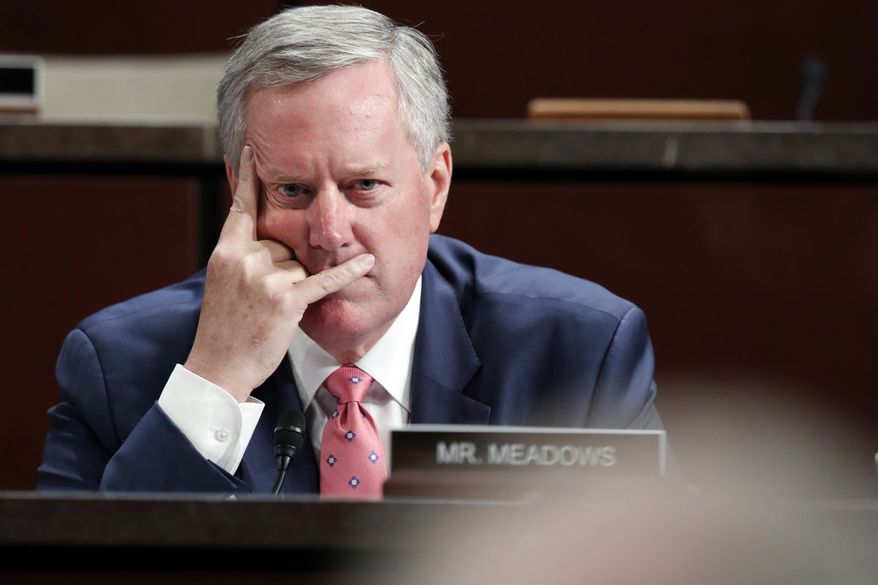 Rep. Mark Meadows, R-N.C., listens during questioning of Department of Justice Inspector General Michael Horowitz during a joint House Committee on the Judiciary and House Committee on Oversight and Government Reform hearing examining Horowitz's report of the FBI's Clinton email probe, on Capitol Hill, Tuesday, June 19, 2018 in Washington. (AP Photo/Jacquelyn Martin)
