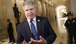 Chairman of the Homeland Security Committee, Rep. Michael McCaul, R-Texas, stops to talk to members of the media after meeting with President Donald Trump and members of the GOP leadership at the U.S. Capitol, Tuesday, June 19, 2018. (AP Photo/Pablo Martinez Monsivais)