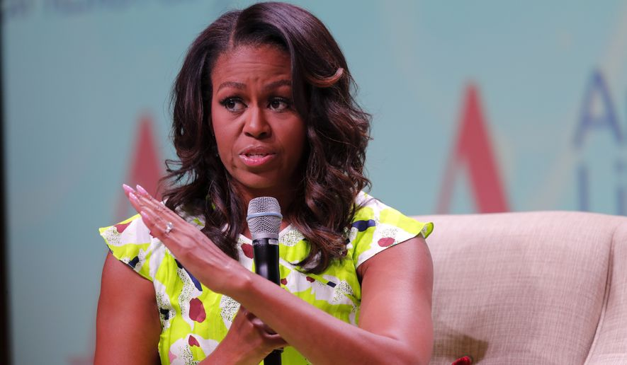 Former first lady Michelle Obama speaks at the American Library Association annual conference in New Orleans, Friday, June 22, 2018. (AP Photo/Gerald Herbert)