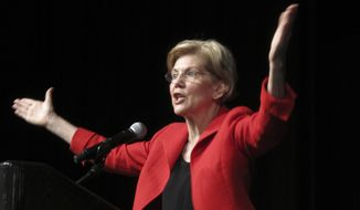 Sen. Elizabeth Warren, D-Mass., delivers the keynote address Saturday, June 23, 2018, to the Nevada Democratic Convention in Reno, Nev. Warren said Nevada will play a pivotal role in the November elections on the road to taking back the White House in 2020. (AP Photo/Scott Sonner)
